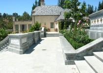 Materials: Finished Granite; Carved Stone Pedestals